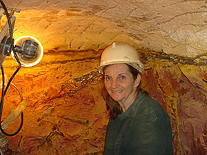 Elisabeth smiling underground in our opal mine
